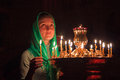 Girl with a candle in the orthodox church Royalty Free Stock Images