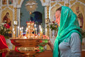 Girl with a candle in the orthodox church Stock Images