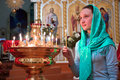 Girl with a candle in the orthodox church Royalty Free Stock Photos