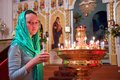 Girl with a candle in the orthodox church Stock Image