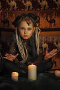 Girl with candles dreadlocks and clothing ethnic style Royalty Free Stock Images