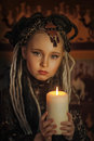 Girl with candles dreadlocks and clothing ethnic style Royalty Free Stock Photos