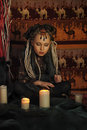 Girl with candles dreadlocks and clothing ethnic style Royalty Free Stock Image