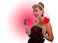 Girl with candy pin up heart and rainbow shaped lollipops pink in the background Stock Photo