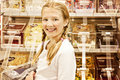 Girl in candy shop Stock Image
