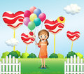 A girl in the candyland with eight balloons Royalty Free Stock Photo