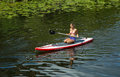 Girl in canoe paddling on a canal in the city stockholm sweden july Stock Image