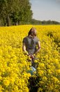 Girl on canola field Stock Photos