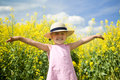 Girl in a canola field Royalty Free Stock Photography