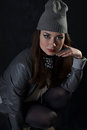 Girl in a cap and a leather skirt ii jacket Stock Image