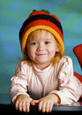Girl in a cap rastafarian Royalty Free Stock Images