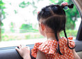 Girl in the car a little looking outside Royalty Free Stock Photography