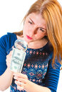 Girl carefully considering money through magnifier the a Stock Photography