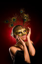 Girl with carnival mask in hand Royalty Free Stock Images