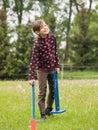 Girl carry hurdles for bunny preparing rabbit jumping Stock Images