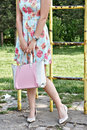 Girl carrying bag young woman walking in a park and carry Royalty Free Stock Images