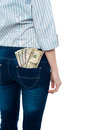 Girl carrying dollars in back pocket with currency notes her cropped image Royalty Free Stock Image