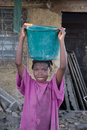 Girl Carrying Water Stock Photo