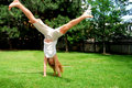 Girl cartwheel Royalty Free Stock Photos