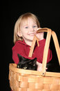 Girl with cat in basket Royalty Free Stock Images