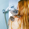 Girl and cat in shower shorthair oriental taking a Royalty Free Stock Image