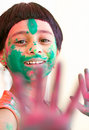 Girl celebrating Holi Stock Photos