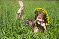 Girl in a chaplet lying from meadow Royalty Free Stock Images