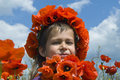 Girl with chaplet of poppies Royalty Free Stock Photos