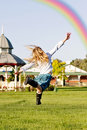 Girl chasing rainbow