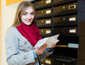 Girl checking correspondence at lobby Royalty Free Stock Photo