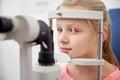 Girl checking vision with tonometer at eye clinic Royalty Free Stock Photo