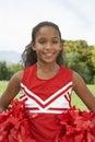 Girl Cheerleader On Soccer Field
