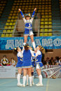 Girl from cheerleaders team jam performs stunt moscow mar at championship and contests of moscow in cheerleading at palace of Stock Photos