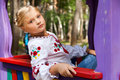 Girl on a child playground with various rides Royalty Free Stock Photo