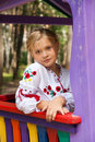 Girl on a child playground with various rides Royalty Free Stock Images