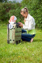 Girl and child in valise.family  to journey Stock Photography