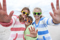 Girl children sisters playing on beach female having fun wearing sunglasses waving to a camera taking selfie photograph a Royalty Free Stock Images