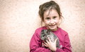 A Girl And A Chinchilla.