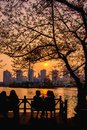 Girl Chit-chat with beautiful sunset view of Seokchon lake Royalty Free Stock Photo