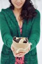 Girl with chocolate holds white and black Royalty Free Stock Photography