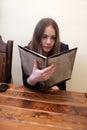 Girl chooses dish Royalty Free Stock Photo