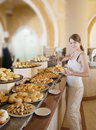 Girl chooses  pastry Stock Photography