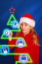 Girl choosing gift on virtual christmas tree Stock Photo