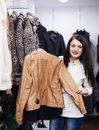 Girl choosing jacket at clothing store ordinary Stock Photo