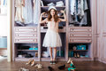 Girl choosing shoes in her wardrobe Royalty Free Stock Photo