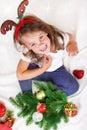 Girl in Chrismas reindeer antlers Stock Images