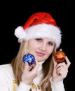 Girl with christmas bulb Royalty Free Stock Photography