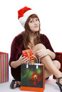 The girl in a Christmas cap with purchases Royalty Free Stock Images