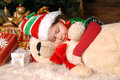 Girl - the Christmas elf sleeps under a fir-tree Royalty Free Stock Photography