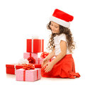 Girl with Christmas gift boxes. Isolated on white Royalty Free Stock Photo